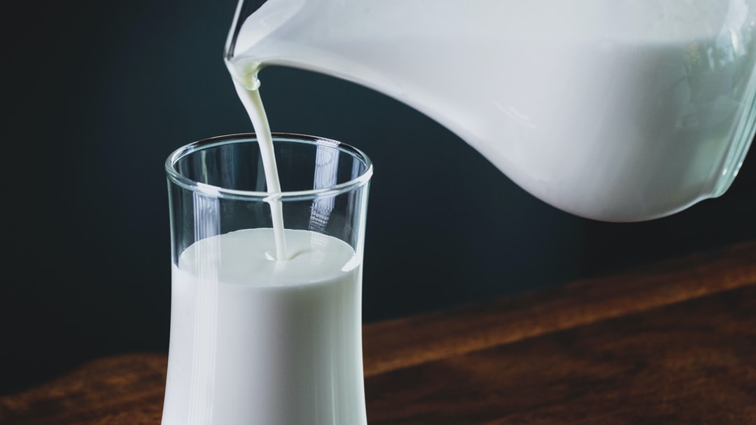 Supply the food bank with milk for one month